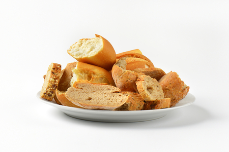 pieces of various types of bread on plate
