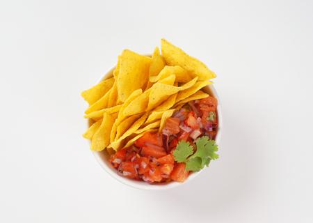 tortilla chips: bowl of salsa fresca and tortilla chips