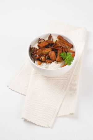stir fry: meat and mushroom stir fry served with rice noodles