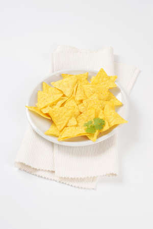 tortilla chips: triangle shaped tortilla chips on plate
