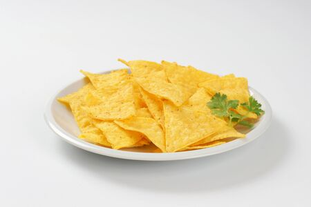 triangle shaped tortilla chips on plate