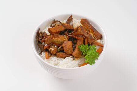 rice noodles: meat and mushroom stir fry served with rice noodles