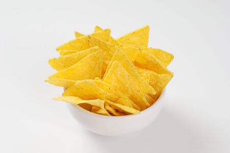 triangle shaped: bowl of triangle shaped tortilla chips Stock Photo