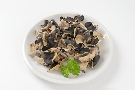 air dried: Heap of air dried wood ear mushrooms on plate