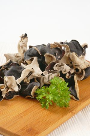 air dried: Air dried wood ear mushrooms on cutting board