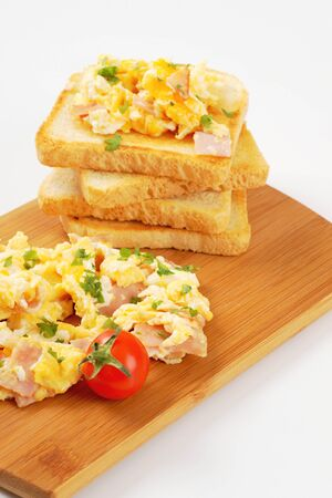 scrambled eggs: toasted white bread and scrambled eggs with ham