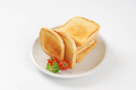 toasted: toasted white bread slices on white plate Stock Photo