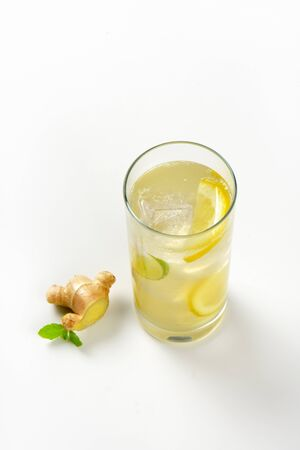 fizz: glass of homemade ginger ale with lemon, lime and ice