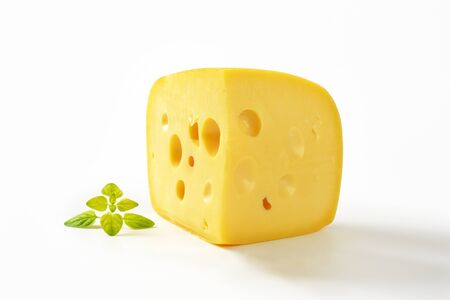 wedge: wedge of yellow medium-hard cheese with eyes Stock Photo