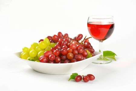 grape juice: bowl of red and white grapes and glass of red wine or grape juice Stock Photo