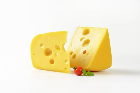 swiss cheese: two wedges of Swiss cheese on white background