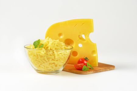 shredded cheese: Swiss style cheese - wedge and grated