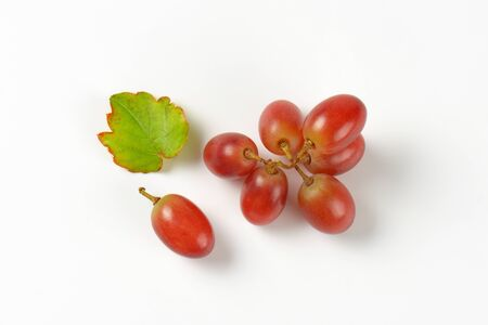 ripe red grapes on white background