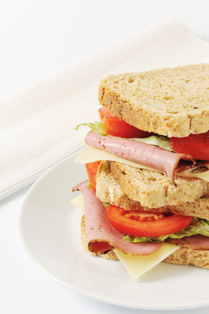 whole grain: Whole grain sandwiches with beef slices and Swiss cheese
