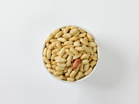 shelled: Bowl of unsalted shelled peanuts