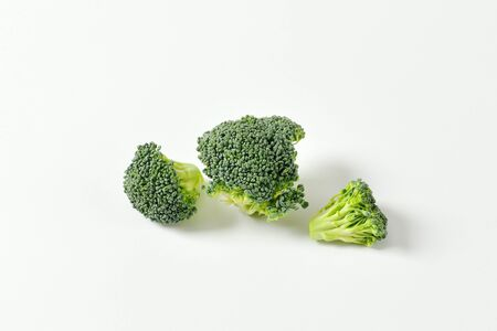 florets: Fresh broccoli florets on off-white background Stock Photo