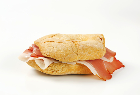 Ring-shaped bread roll (friselle) with slices of Schwarzwald ham Stock Photo