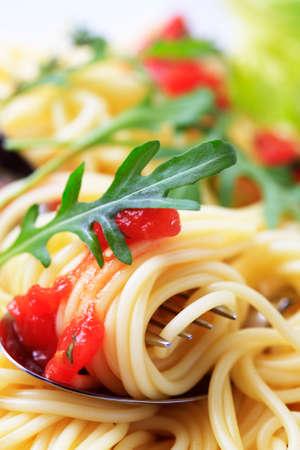 Macro shot of spaghetti twirled around a fork