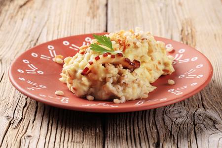 kasha: Dish of mashed potato with peeled barley on wooden background