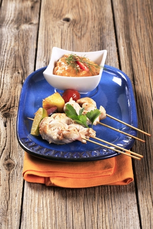 medley: Chicken skewers and vegetable dipping sauce
