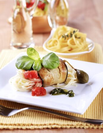 meatless: Spaghetti wrapped in a slice of grilled aubergine Stock Photo
