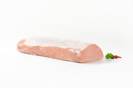 pork  loin: Raw boneless pork loin on white background
