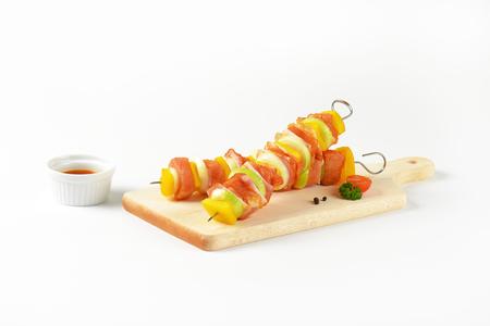 marinade: Raw pork skewers glazed with honey marinade