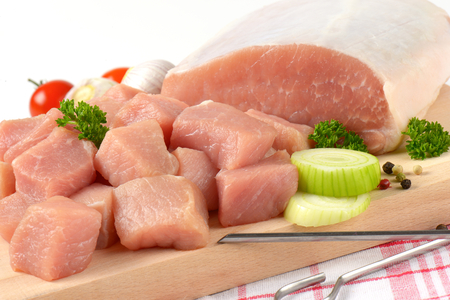 to lean: Diced lean raw pork on cutting board Stock Photo