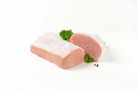loin: Raw boneless pork loin on white background