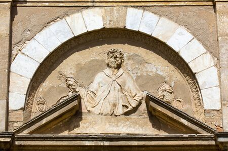 volterra: Relief on the front facade of the Church of San Pietro in Selci in Volterra, Tuscany, Italy Stock Photo