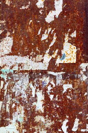 scraped: Scraped posters on rusty metal panel