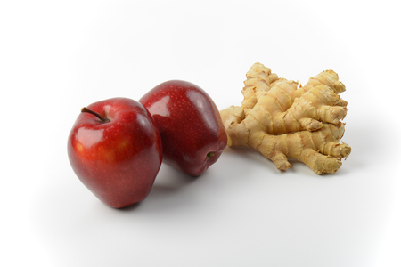 ginger root: two fresh red apples and ginger root