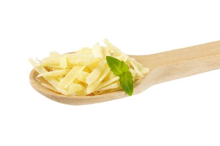 shredded cheese: spoon of shredded parmesan cheese with basil