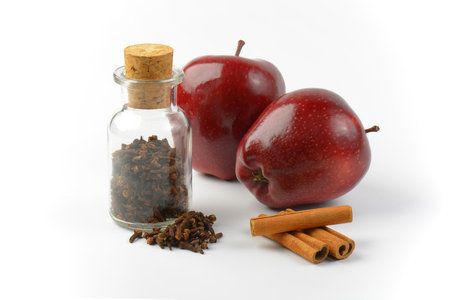 cloves: red apples, cinnamon sticks and cloves Stock Photo