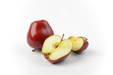 halved  half: one whole red apple, one half and slice