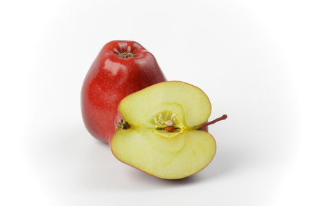halved  half: One and a half red apples on off-white background