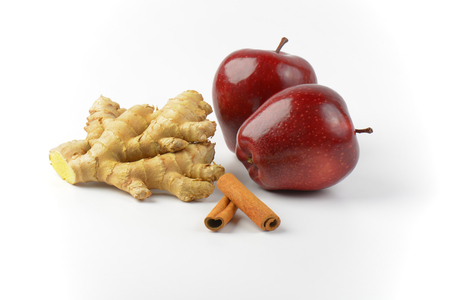 ginger root: two fresh red apples, ginger root and cinnamon sticks