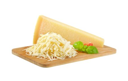 Parmesan: grated parmesan cheese on wooden cutting board Stock Photo