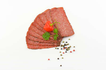 pepper salami: Thin slices of black pepper salami with peppercorns and red chili pepper