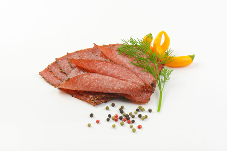 pepper salami: Thin slices of black pepper salami with peppercorns and yellow chili peppers