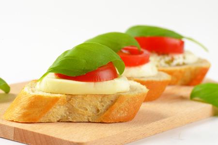 Bread-based mozzarela tomato canapes with fresh basil Stock Photo
