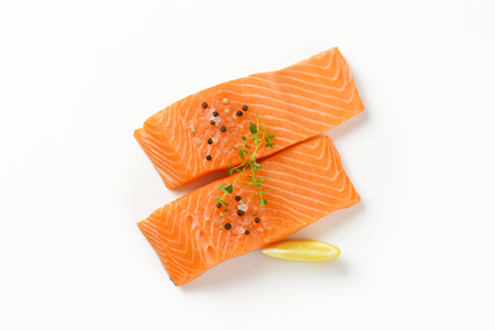 two fresh salmon fillets with salt, spice and thyme