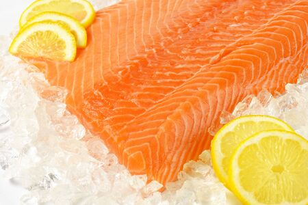 detail of raw salmon fillet on ice Stock Photo