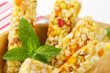Cereal bars with pieces of dried apricot and apple Stock Photo