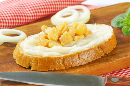 greaves: Slice of bread with lard and greaves Stock Photo