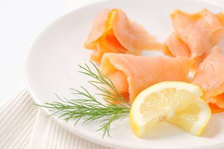 salmon ahumado: Thin smoked salmon slices on plate