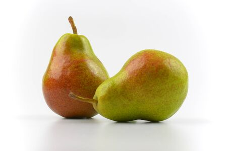 luscious: close up of two ripe pears on white background