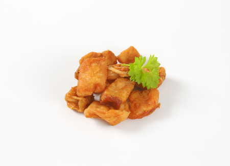 rinds: pile of pork scratchings on white background Stock Photo