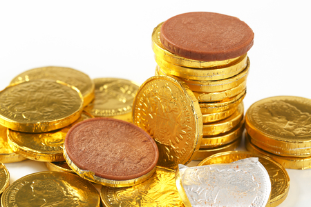 foil: Gold foil covered chocolate coins Stock Photo