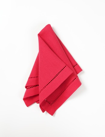 Hemstitched red linen dinner napkin Stock Photo